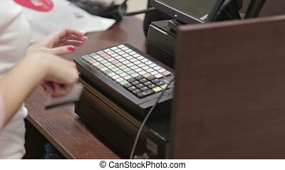 Cash register in the clothing store. Employees and buyers