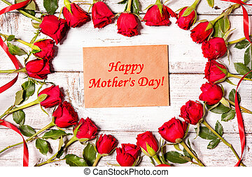 Mothers day background - Heart shape from red roses and card...