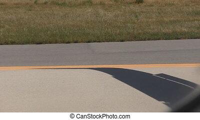 Aircraft driving on airport runway - Aircraft passenger...