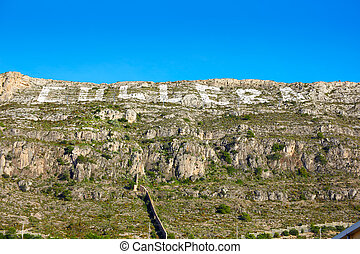 Cullera mountain with white sign writting on Valencia of...