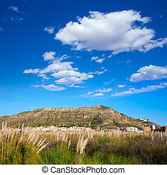 Cullera mountain with white sign writted on in - Cullera...