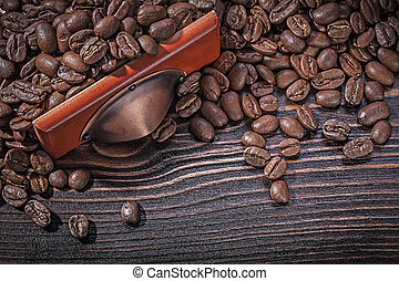 Roasted coffee beans on vintage wooden board directly above