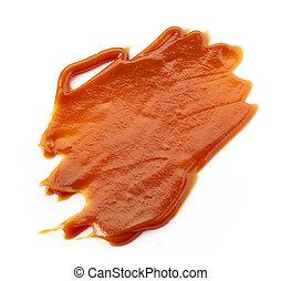 Caramel sauce on white background