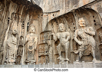 Figures in Longmen Caves. Longmen Grottoes with Buddha's...