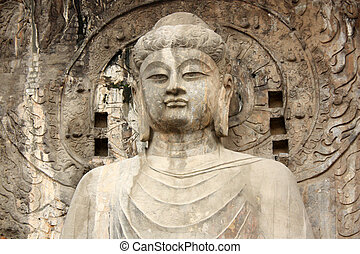 Buddha's statue in Longmen Grottoes at Yi River, Luoyang...