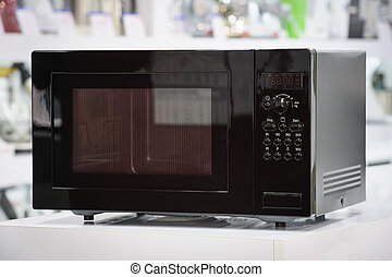microwave oven in retail store - single black microwave oven...