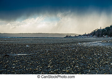 Puget Sound Shoreline - Light breaks through storm clouds...