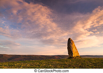 Menhir on the hill at sunset in Morinka village, Czech...