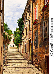 Cozy and narrow streets in Pulas medieval old town, Croatia