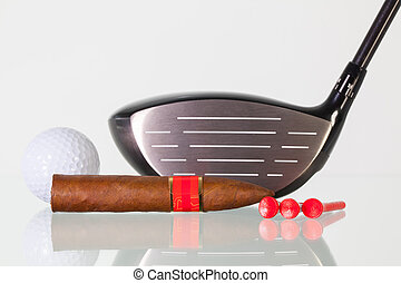 Golf driver and different cigars on a glass desk - Golf...