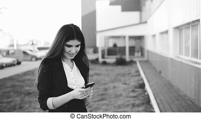 Fellow workers using phone, black and white full HD