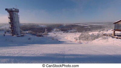 Landscape of a ski resort, view of one of the tracks covered...