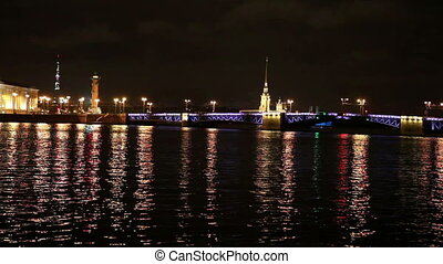 Night view of the University embankment of St. Petersburg through the Neva River- Peter and Paul fortress, Palace bridge, Vasilievsky island