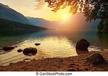 Sunset on the lake Bohinj in Triglav national park, located...
