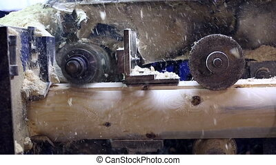 Milling cutter cuts log and sawdust fly away - View on...