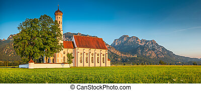 Famous St Coloman church near Fussen at sunset, Bavaria,...