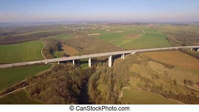 4K Aerial, Flight along a huge bridge in germany - Shot is...