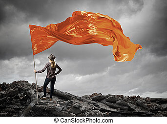 Woman with orange waving flag - Student girl in casual with...
