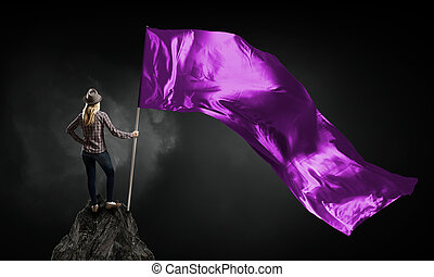 Woman with purple waving flag - Student girl in casual with...