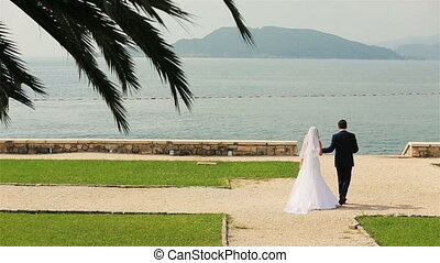 Happy wedding couple walking on Montenegro, Budva and...