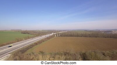 4K Aerial, Flight along a bridge - Shot is straight out of...