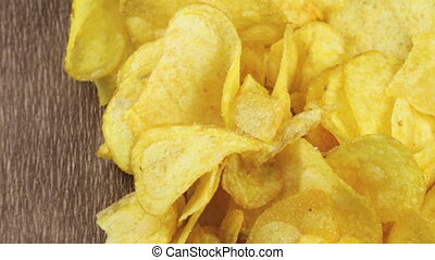 Potato Chips on the Table Rotating - Potato chips are on the...