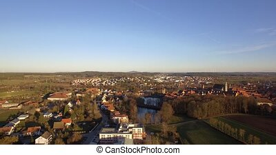 4K Aerial, German beautiful village - Shot is straight out...