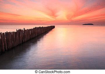 Bamboo wall in the sea and beautiful sunrise at Saphan Hin,...