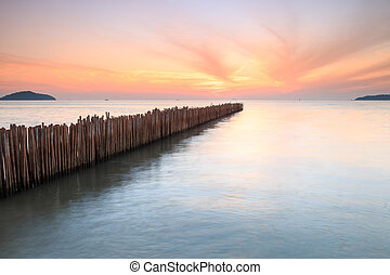 Bamboo wall in the sea and beautiful sunrise at Saphan Hin,...