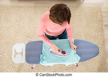 Woman Ironing Clothes With Steam Iron