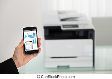 Businesswoman Hand Giving Print Command On Smart Phone -...