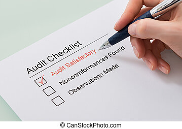 Woman Filling Audit Checklist Form