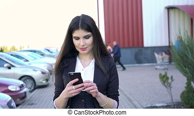 business woman is walking and touching at phone - business...