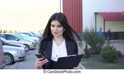 Successful girl is going using phone and notebook full HD