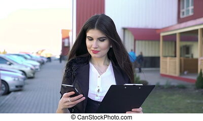 Pretty girl is going using notebook and phone full HD