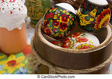 Easter eggs in a wooden bowl - Multi-colored Easter eggs in...