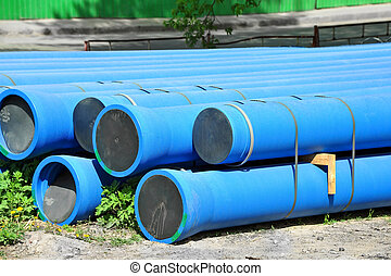 Stacked PVC pipe - Stacked blue PVC pipe on construction...