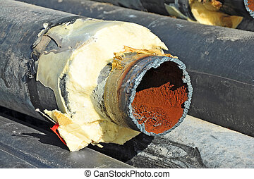 Steel pipe with heat insulation - Rusty steel pipe with heat...