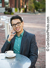Young asian man in outdoor cafe - Successful young asian man...