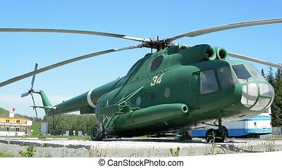 Green helicopter - Helicopter on the background of sky and...
