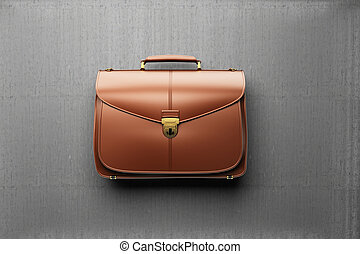 Briefcase on the background of gray concrete wall - Closeup...