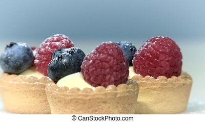 Confectioner prepares tartlets with blackberry and...