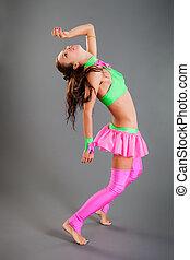 Slim Girl in Dance Costume Poses Bends Body Backward -...