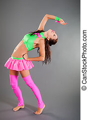 Slim Girl in Dance Costume Poses Bends Body Backward