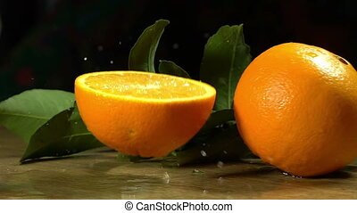 Group of oranges with leaves on wooden boards - Group of...