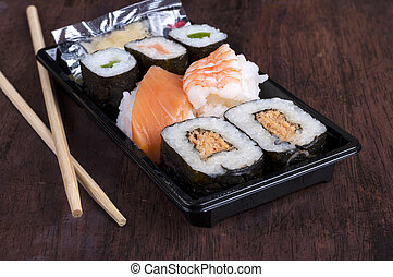 Black sushi box - sushi box or bento box with assorted sushi...