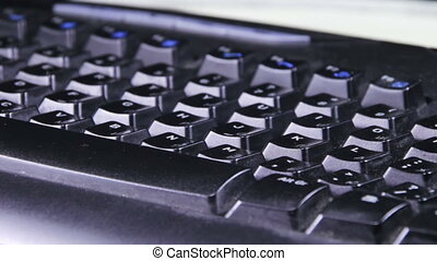 Black Keyboard Rotates - Black keyboard rotates on the table...