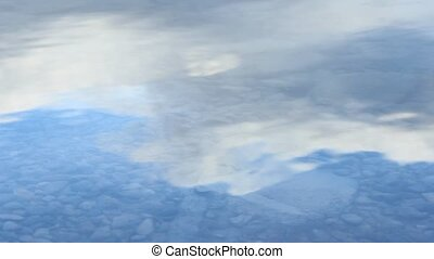 Stone Splashes Calm Lake Surface - Stone thrown into lake