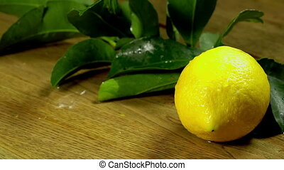 Lemons with leaves on wooden boards - Falling lemons with...