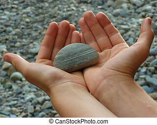 Grey Future - Hands holding a rock, hoping for a bright...